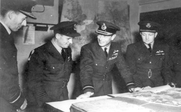 AVM R A Cochrane, Wg Cdr Guy Gibson, King George VI and Gp Capt Whitworth discussing the 'Dambusters Raid' in May 1943